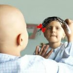 Young cancer patient sketching her hair on the mirror